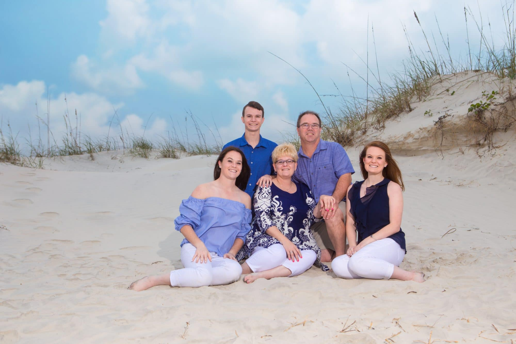 Ponce Inlet Family portrait by the dunes by Ponce Inlet photographer that specializes in Ponce Inlet photography
