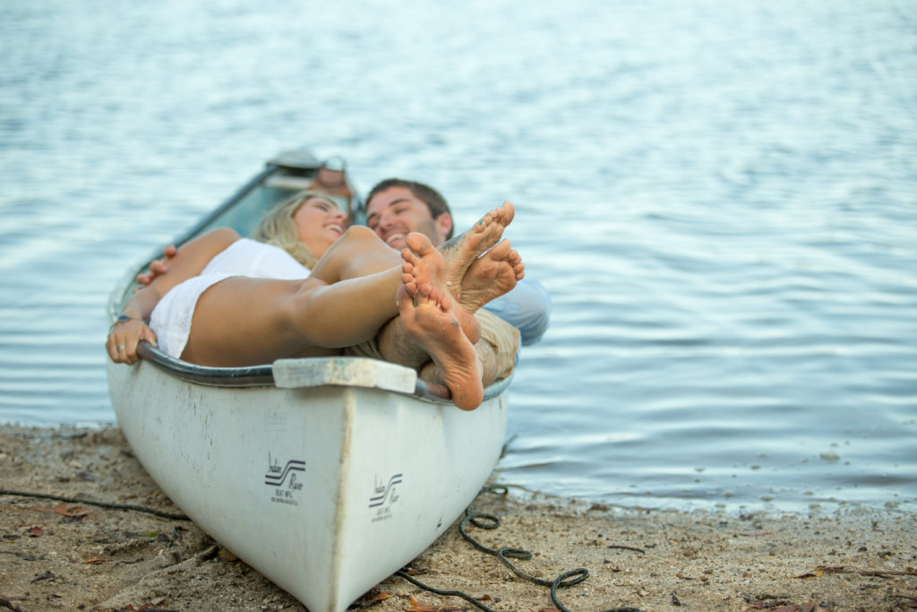 Melbourne beach photographer's engagement shoot of a couple in a canoe by the inter coastal