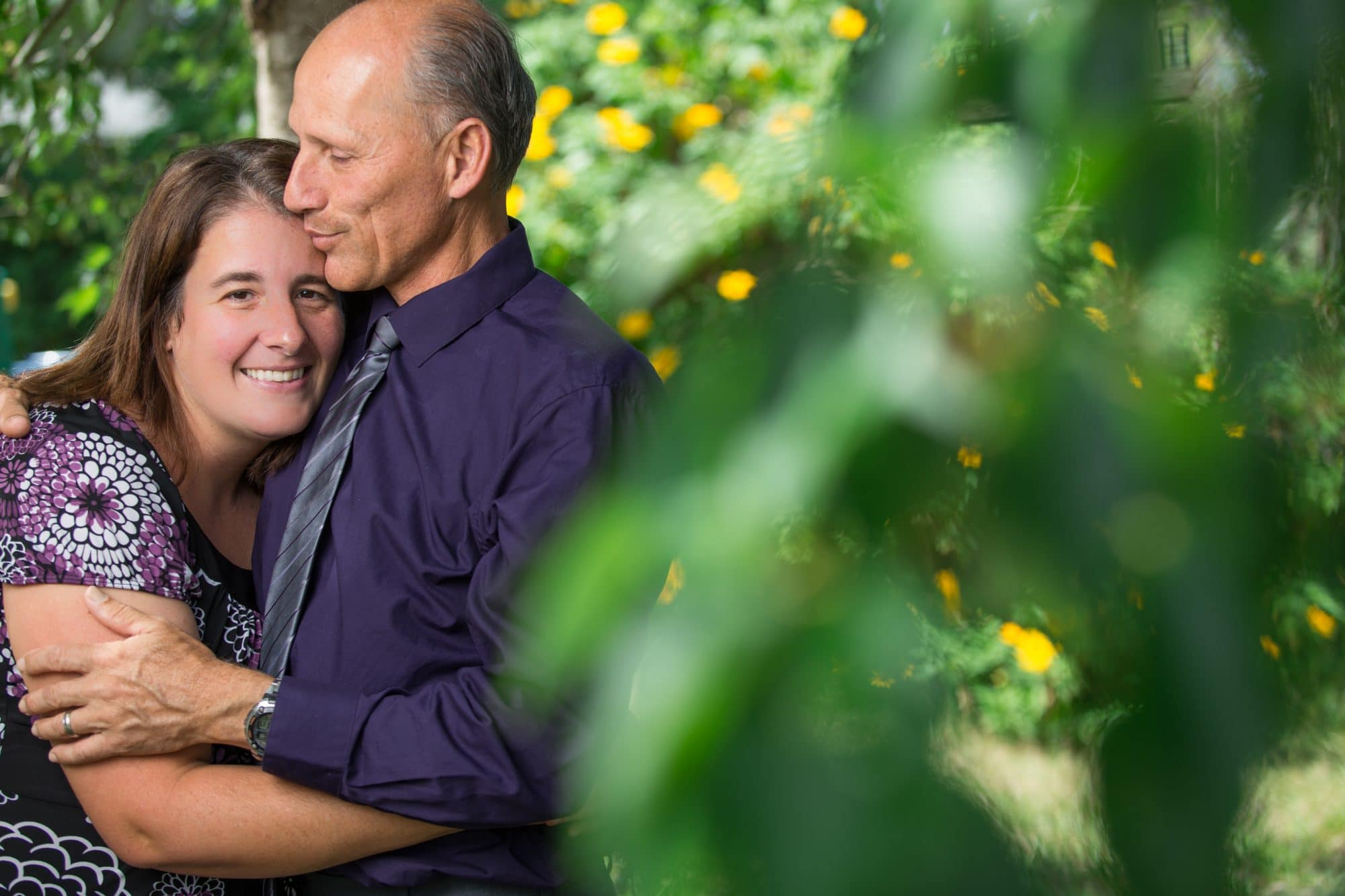 Spring portrait of couple photographed by a local Orlando engagement photographer for a spring family portrait session