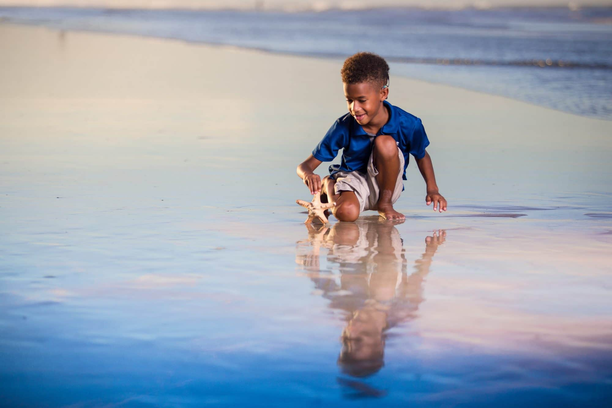 Ormond beach family portrait session on the beach at their vacation rental