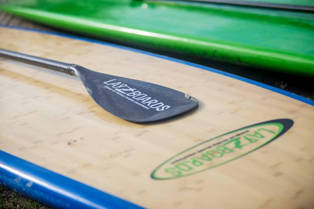 New Smyrna Beach family photography of a paddleboard