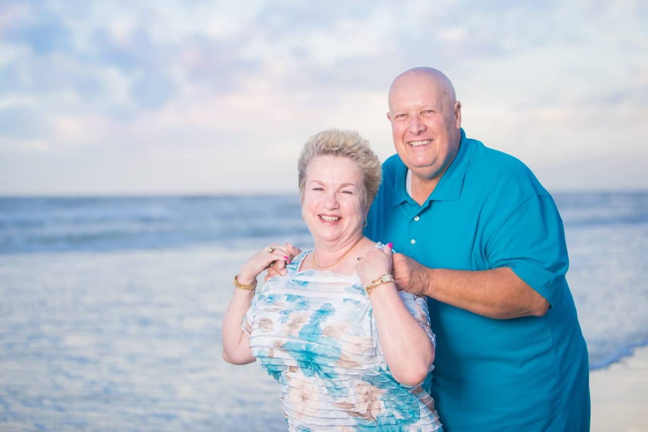 St. Augustine family photographer documents family vacation on the beach at sunset