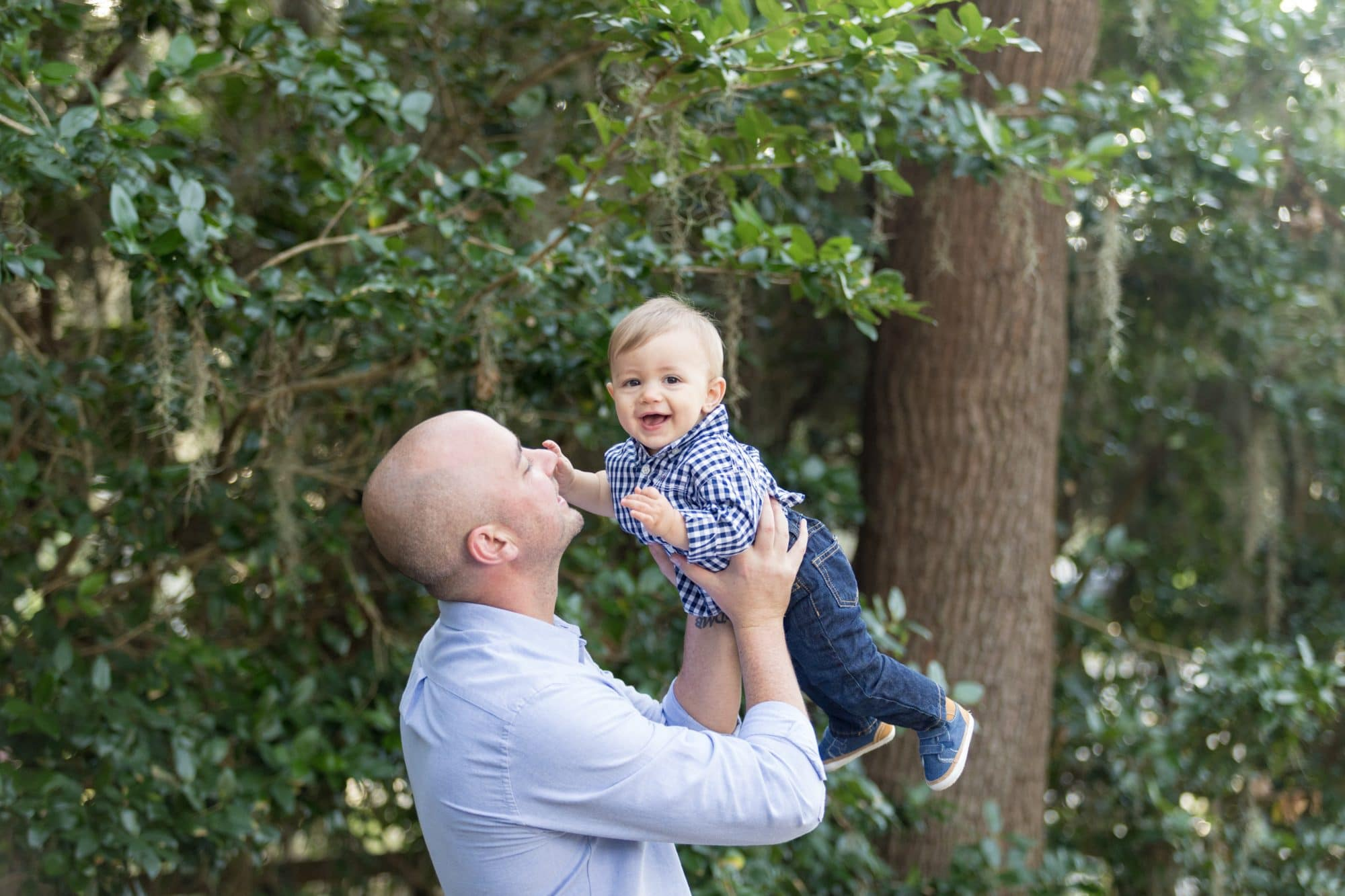 Family portrait photographer captures photograph of dad and son smiling