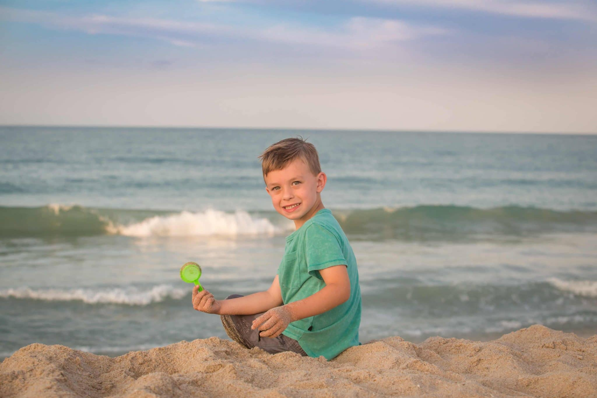 Boy playing in sand on Melbourne Beach by Melbourne fl photographer