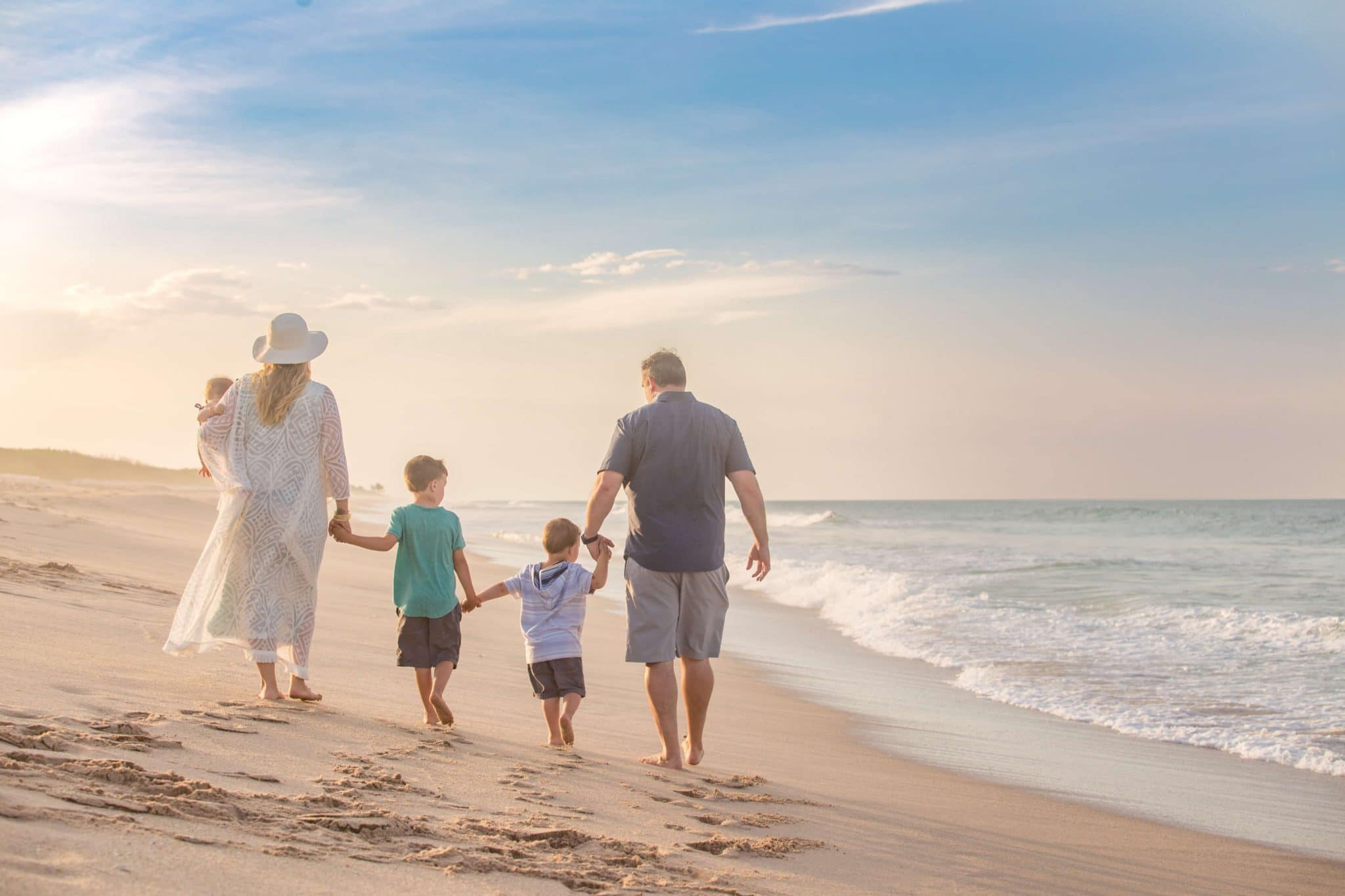 Melbourne of photographer image of family walking on the beach at Sebastian Inlet State Park
