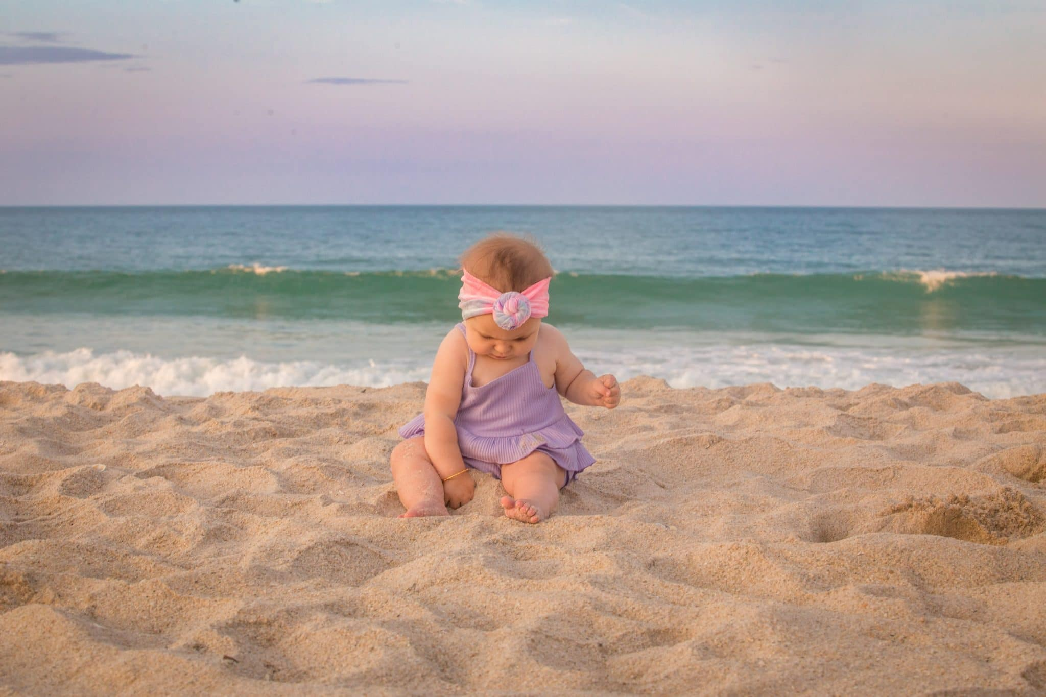 Baby playing in the sand on Melbourne beach in Florida