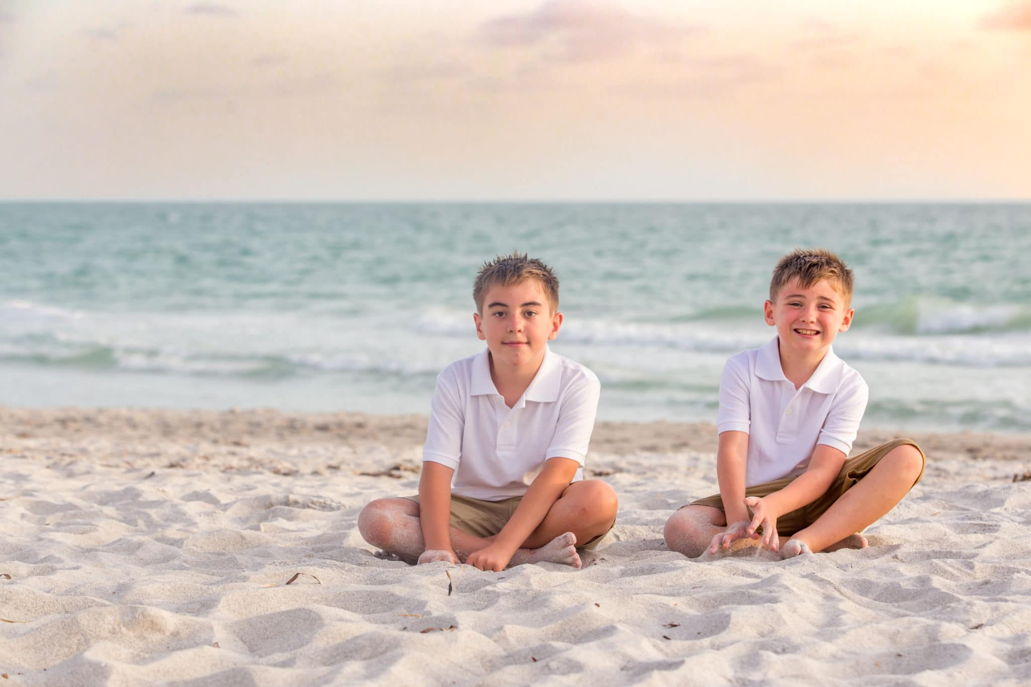 Longboat key family beach photography at sunset with ocean in the background and white sand